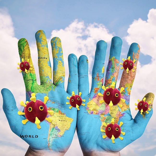 COVID world hands globe